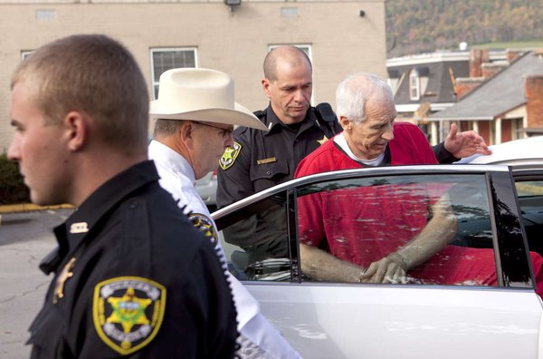 Jerry Sandusky is led to a police car after his 30 to 60 year sentence. (Photo: Ed Hille, Staff Photographer at the Philadelphia Inquirer)