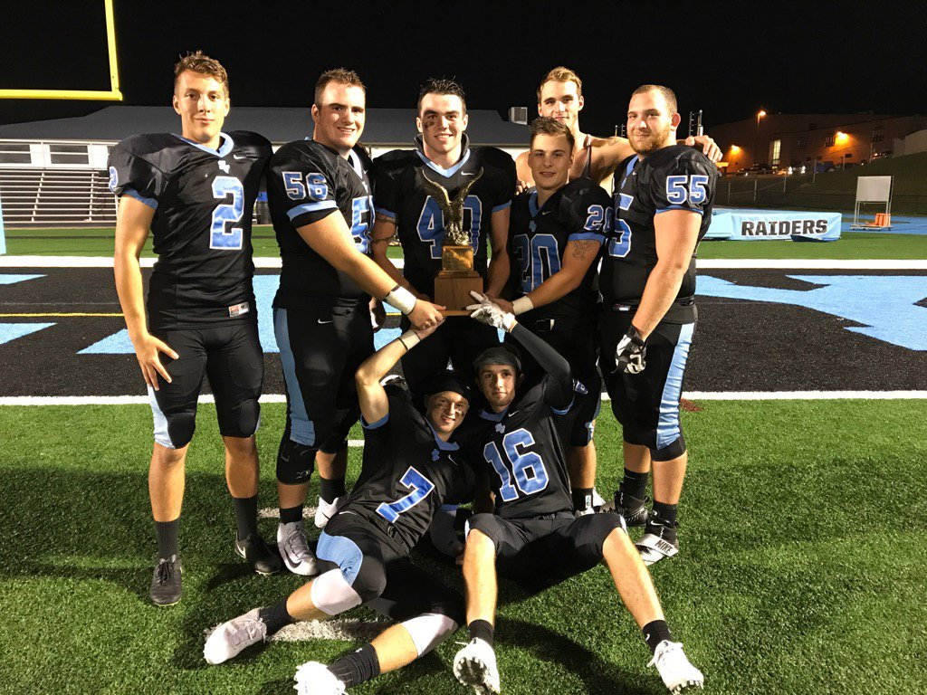 Members of the Raiders celebrate after claiming the Eagle Traveling Trophy