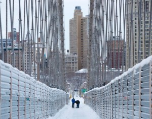 The Brooklyn Bridge in New York is shown covered in snow. The Northeast United States received more than a foot of snow over the weekend.  Photo courtesy of the New York Daily News