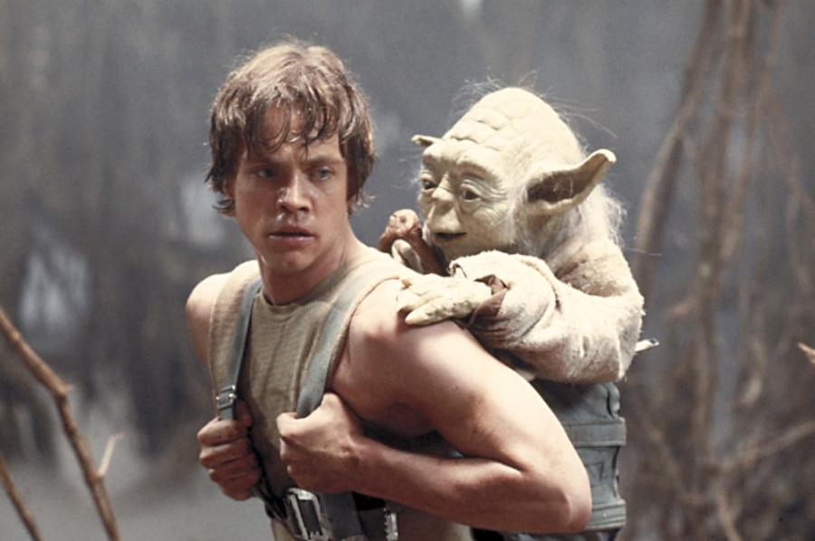 ORG XMIT: NYET475 FILE - This 1980 publicity image originally released by Lucasfilm Ltd., Mark Hamill as Luke Skywalker and the character Yoda appear in this scene from