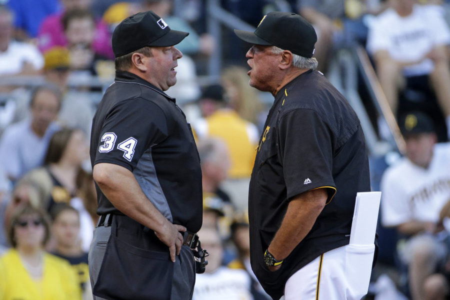 Pittsburgh Pirates manager Clint Hurdle, right, speaks his mind to umpire Sam Holbrook after being ejected during the first inning of a baseball game against the Milwaukee Brewers in Pittsburgh, Wednesday, July 20, 2016. (AP Photo/Gene J. Puskar)